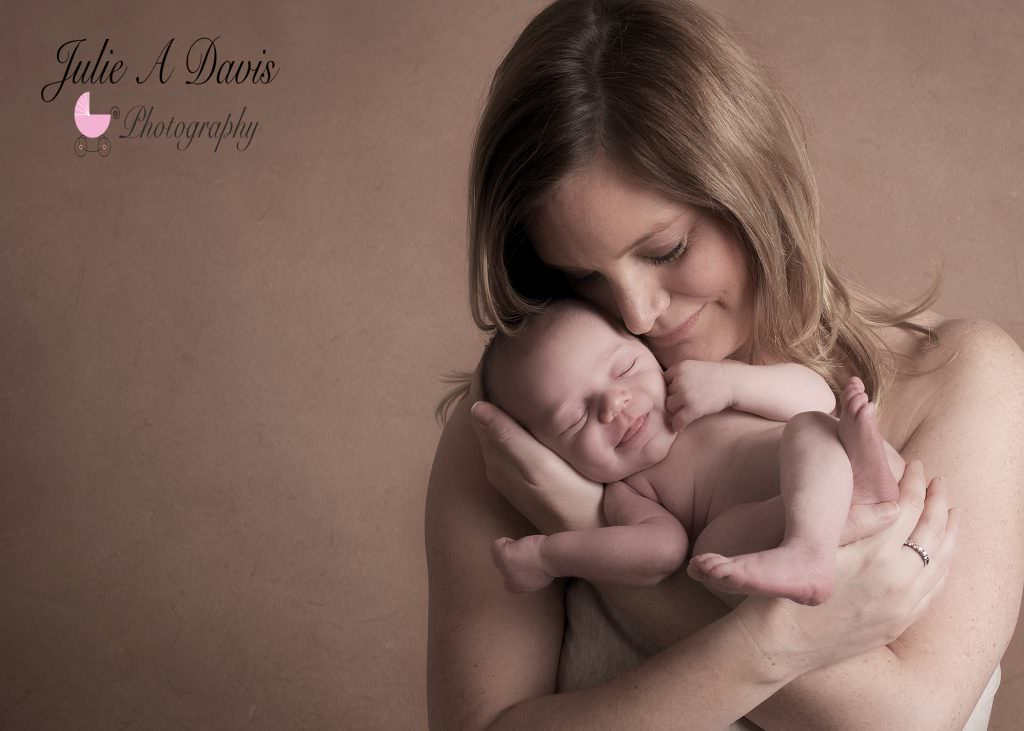 Newborn baby and mother by Hampshire photographer Julie A Davis
